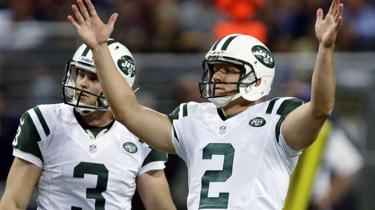 Jets kicker Nick Folk, right, celebrates alongside Robert