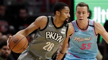 Nets guard Spencer Dinwiddie drives up against Miami