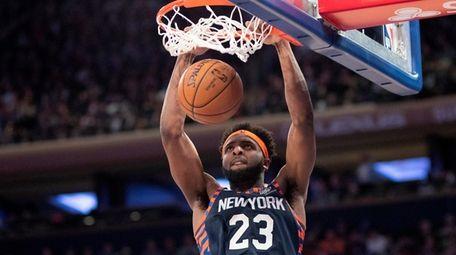 New York Knicks center Mitchell Robinson (23) dunks