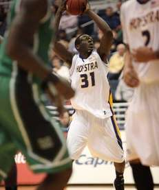 Hofstra's Moussa Kone looks to pass against Marshall