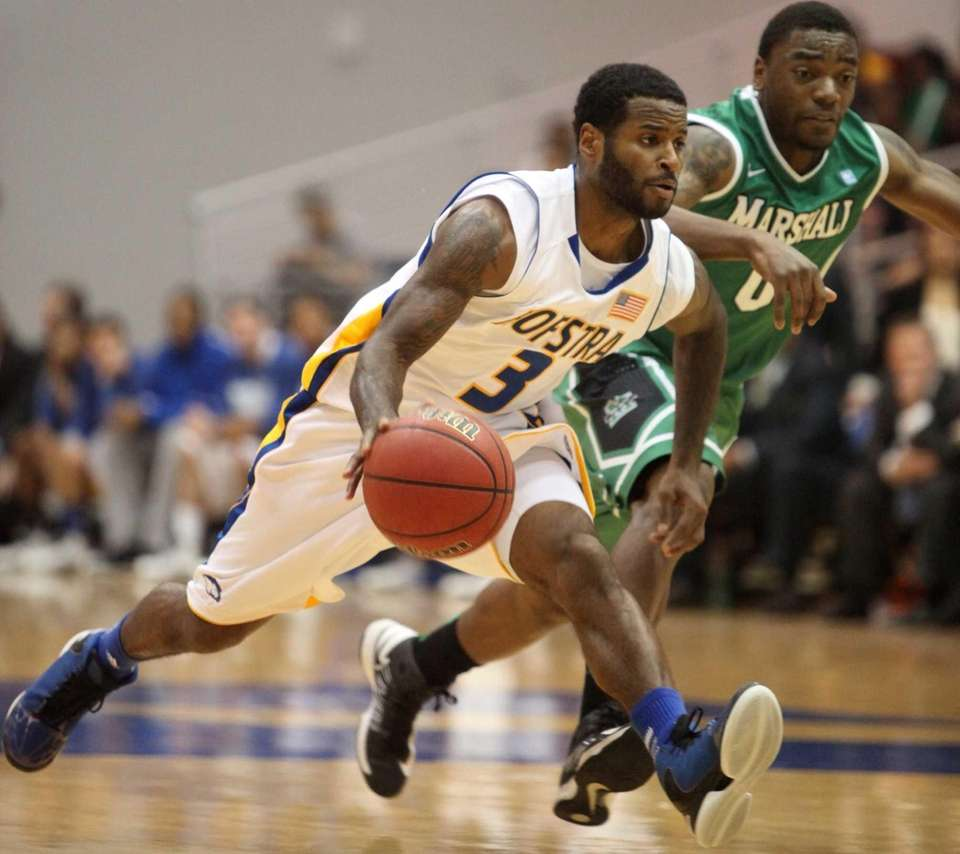 Hofstra's Steve Mejia, left, dribbles past Marshall's Chris