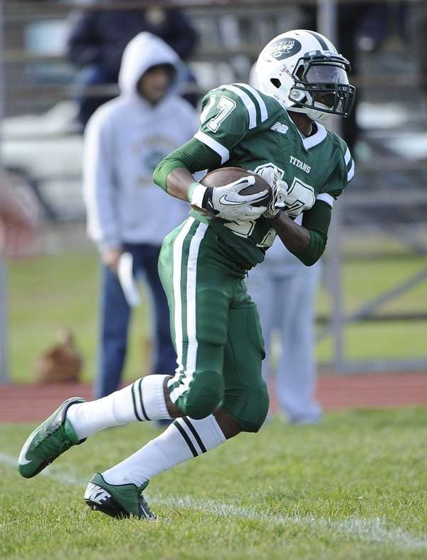 Holy Trinity's Kristian Green runs the ball against