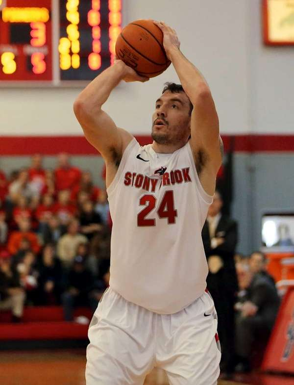 Stony Brook's Tommy Brenton shoots against Sacred Heart.
