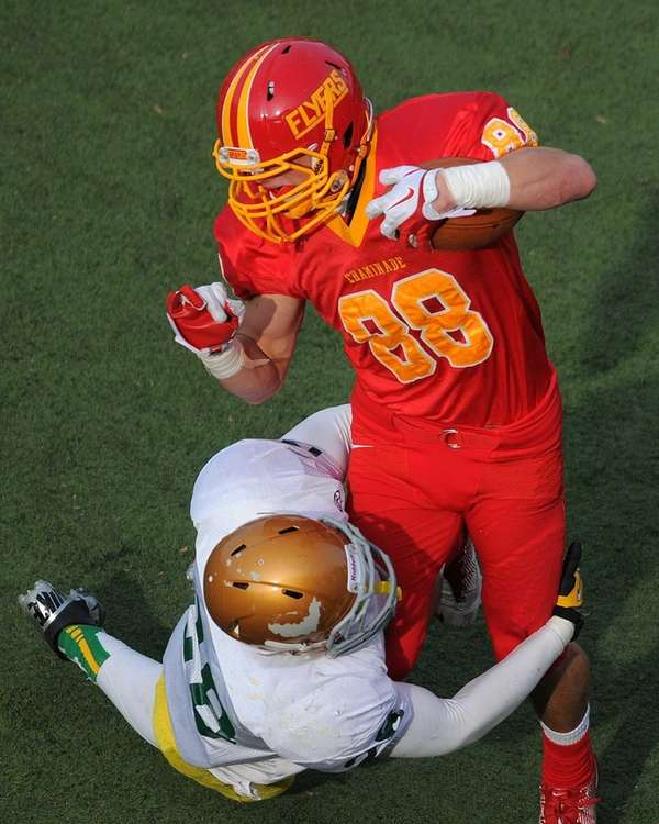 Chaminade receiver Thomas Zenker, right, fights for yards