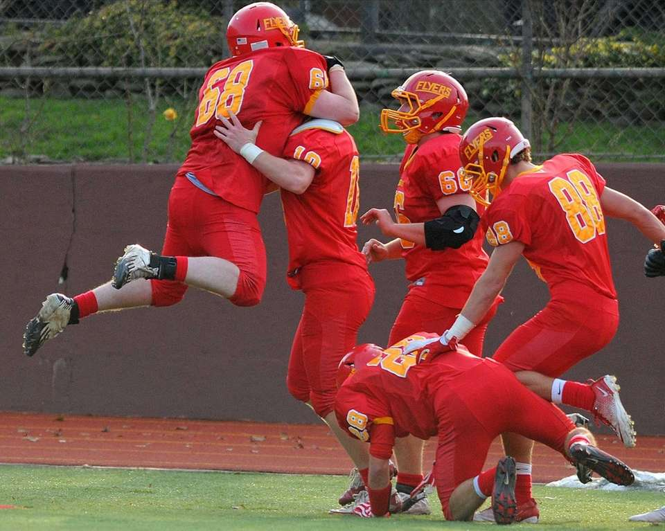 Chaminade's Timothy Muller, second from left, gets a