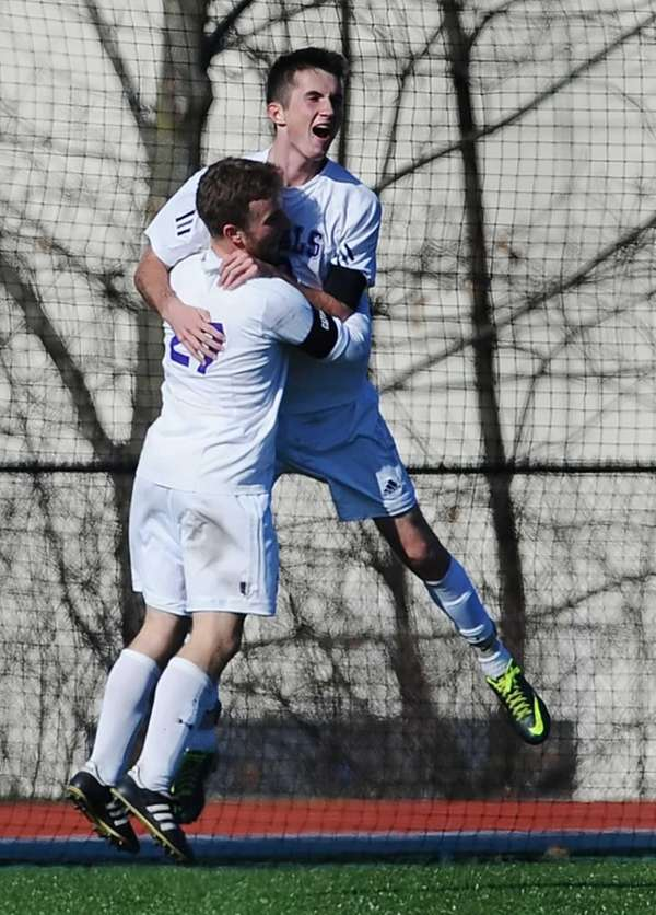 Port Jefferson's Blake Bohlen, top, celebrates his game-winning
