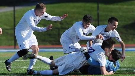 Port Jefferson players celebrate at the final whistle
