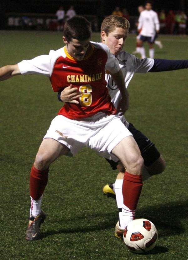Chaminade's Carney Mahon battles with Canisius' Jake Montante