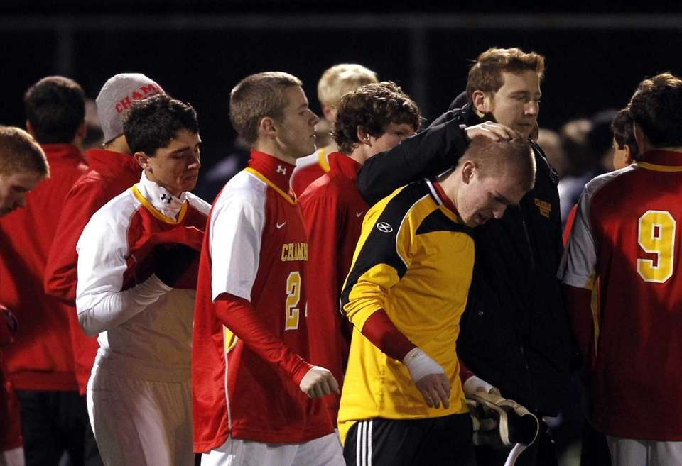 Chaminade goalie Brian Westerman, right, is comforted as