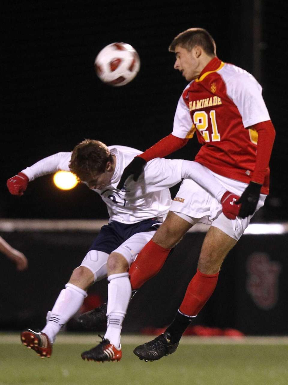 Chaminade's Hunter Frey heads the ball away from
