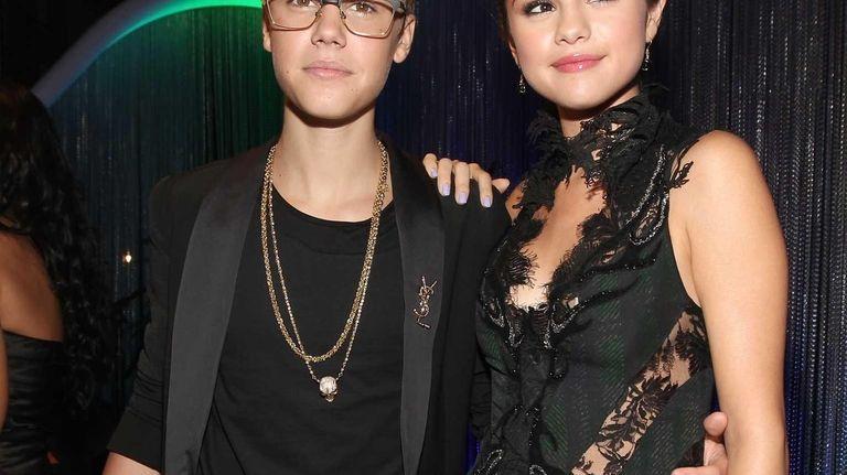 Singer Justin Bieber and actress Selena Gomez arrive