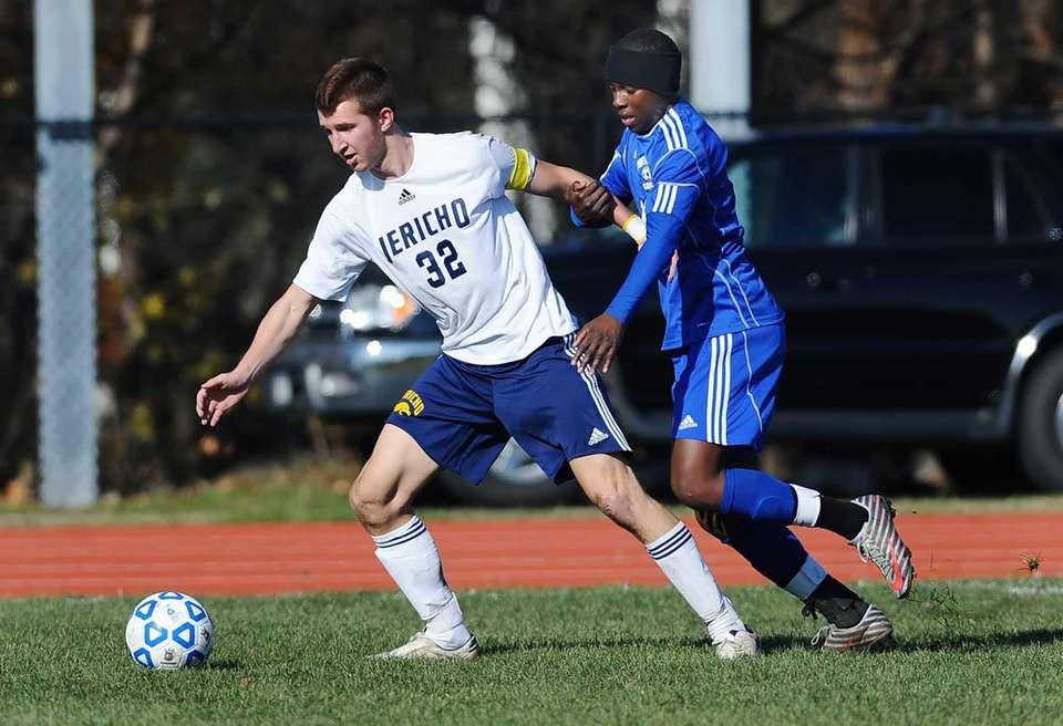 Jericho's Derek Medolla, left, shields the ball from
