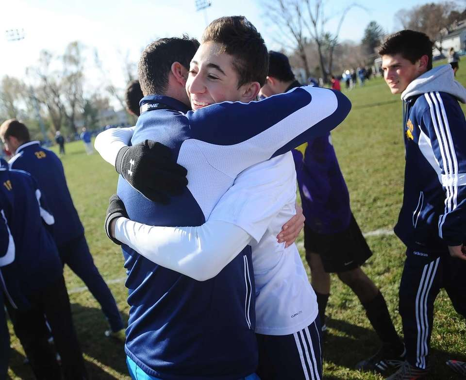 Jericho's Drew Shuman, right, hugs head coach Dani