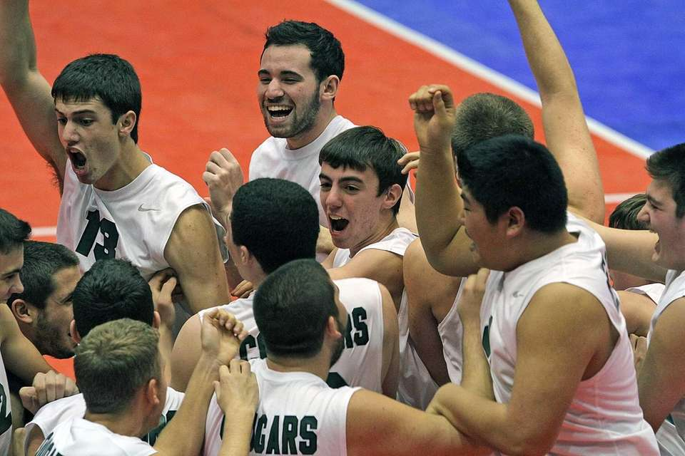 Bellmore JFK players celebrate on court moments after