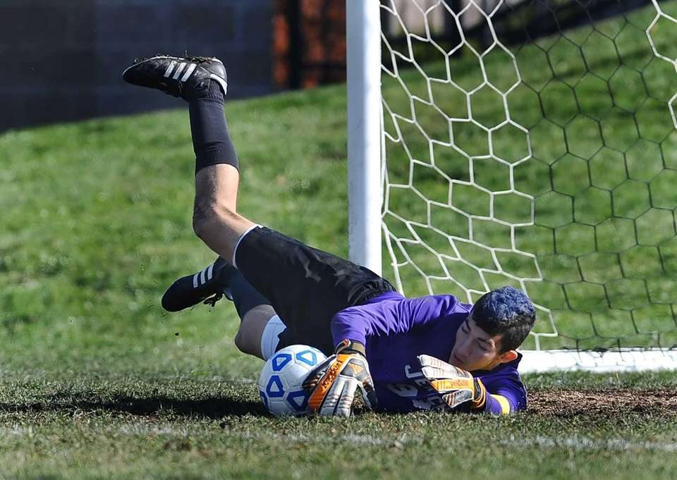 Jericho's goalkeeper Ari Lewis makes a diving save.