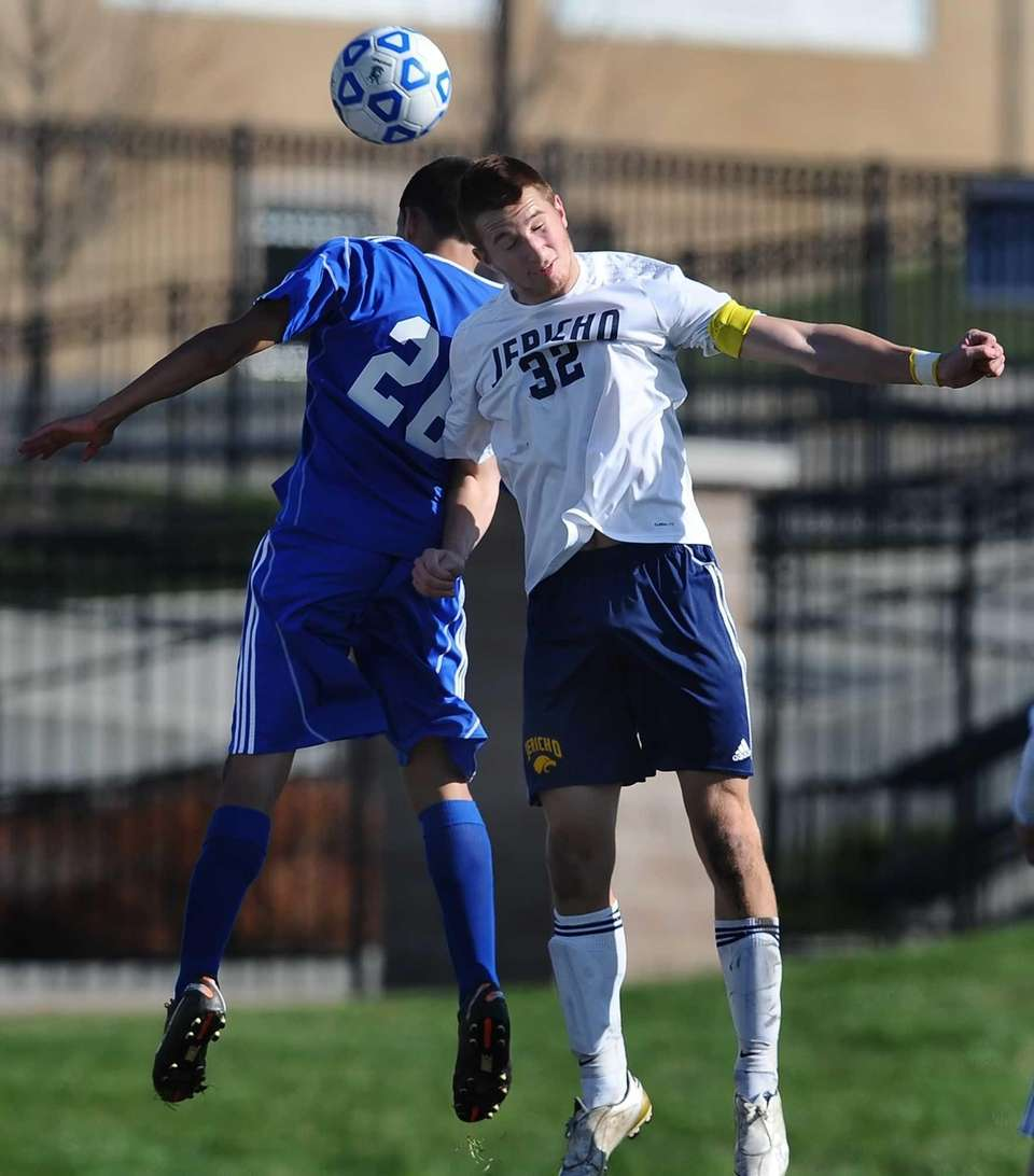 Jericho's Derek Medolla, right, wins a header against