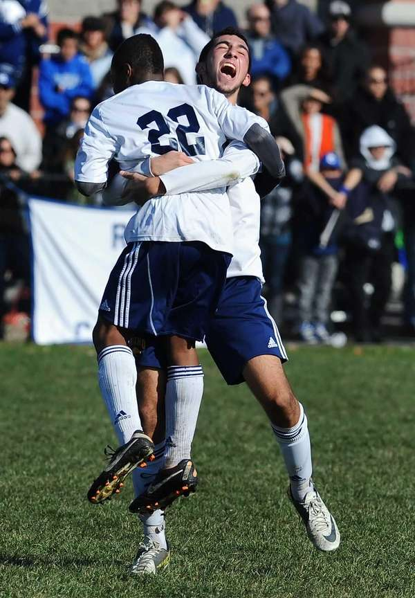 Jericho's Brian Lowenstein, right, celebrates with teammate Ajani