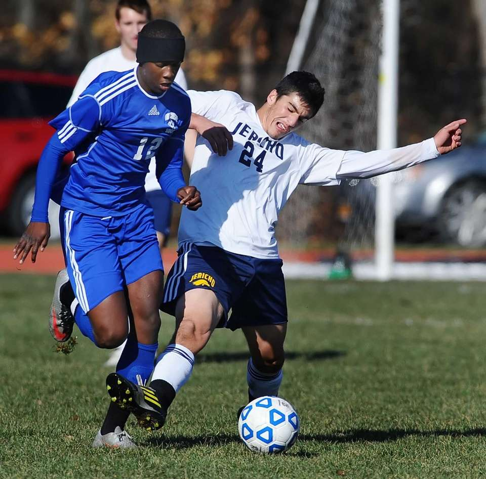 Jericho's Michael Blumberg, right, tackles the ball away