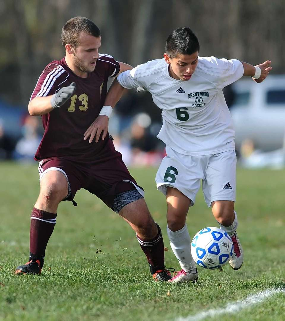 Brentwood's Ever Torres, right, dribbles the ball along
