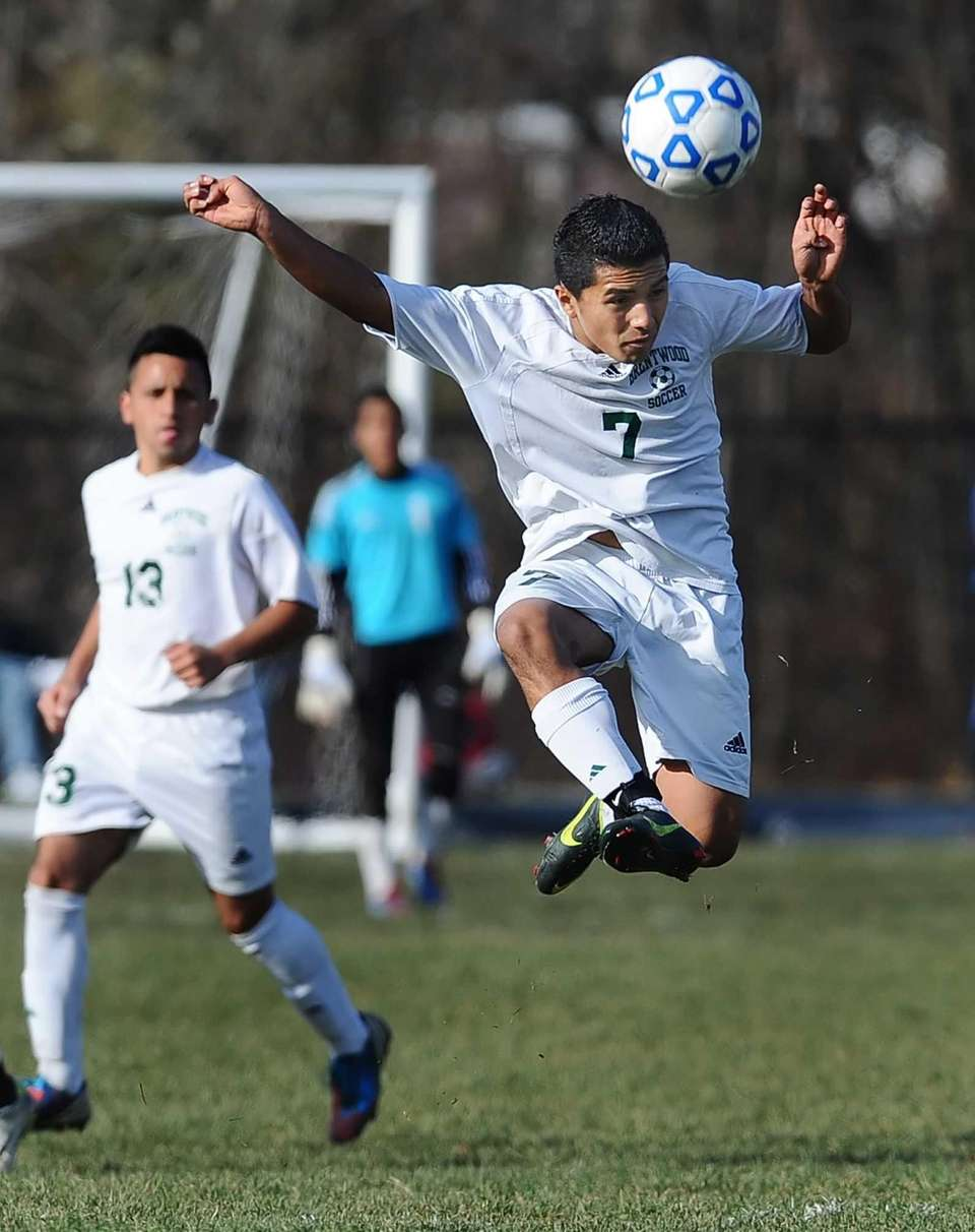 Brentwood's Carlos Menjivar jumps for a clearing header