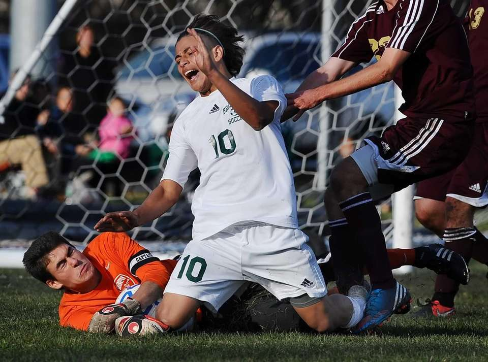 Brentwood's Carlos Escobar, right, goes down as Arlington