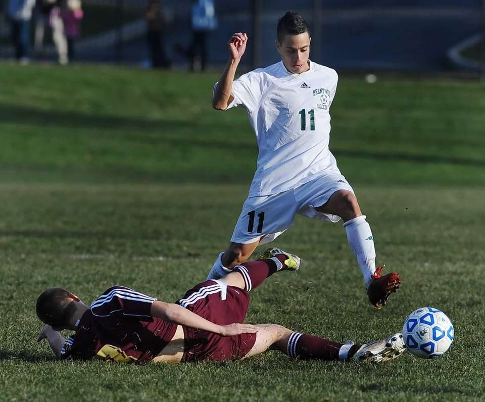 Brentwood's Eric Molina, right, avoids the slide tackle