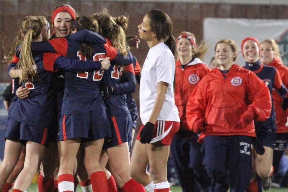 South Side celebrates after beating Jamesville-Dewitt for the