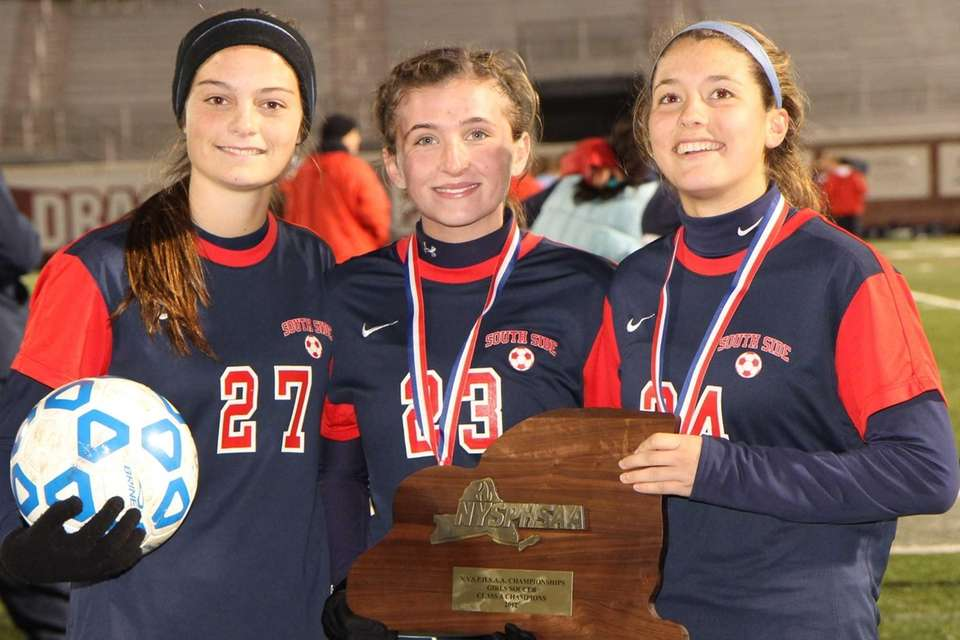 Michaela Lynch, Meghan Hines and Alex Reis celebrate