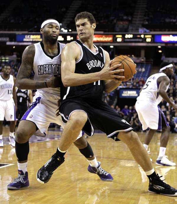 Brooklyn Nets center Brook Lopez, right, works against