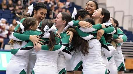 Farmingdale teammates celebrate after a well-executed performance in