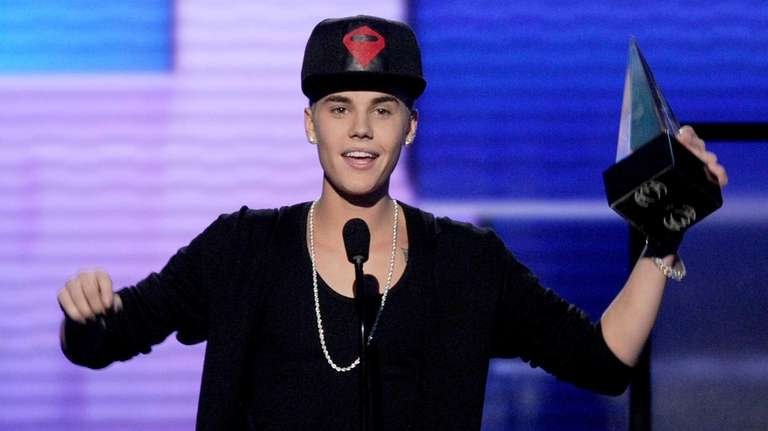 Singer Justin Bieber accepts the award for Favorite