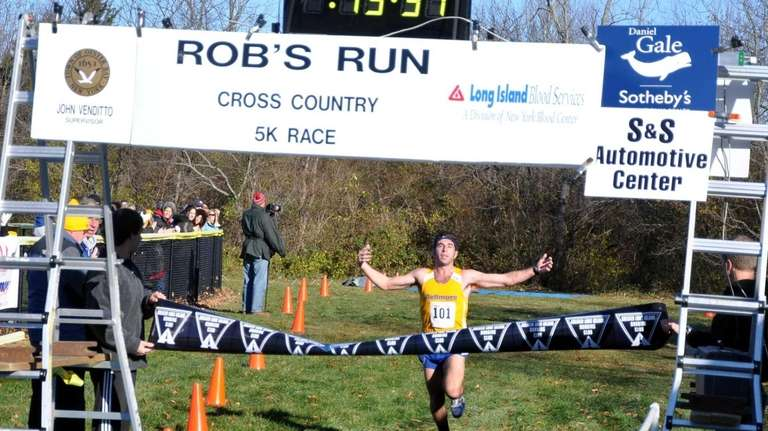 Chris Mammone clears the finish line in the
