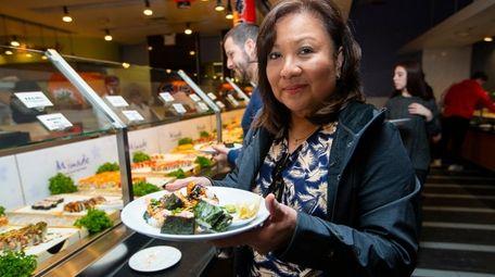 Anne Devin of Deer Park visits the sushi