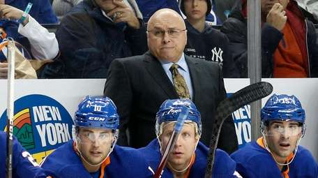 Islanders head coach Barry Trotz looks on during