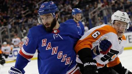 The Rangers' Phillip DiGiuseppe, left, and the Flyers'