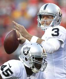 Oakland Raiders quarterback Carson Palmer passes behind the