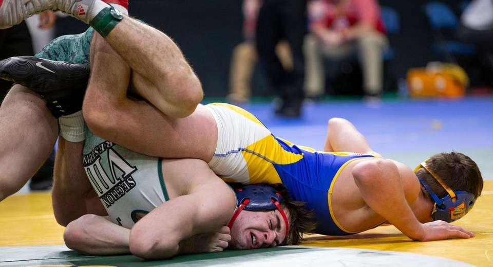 Tyler Mousaw of South Jefferson/Sandy Creek wrestles against