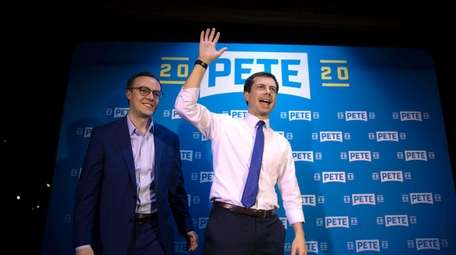 Democratic presidential candidate Pete Buttigieg, right, and husband,