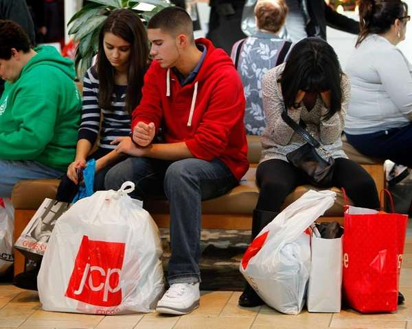 Black Friday shoppers take a break from shopping.