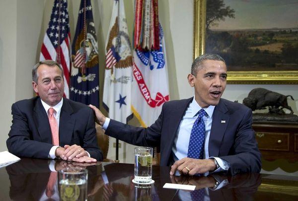 President Barack Obama acknowledges House Speaker John Boehner