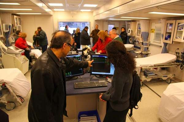 Emergency workers look through a temporary emergency room