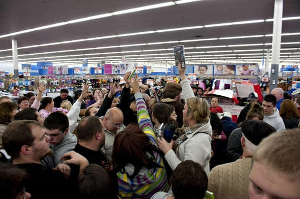 File photo of shoppers at a Black Friday