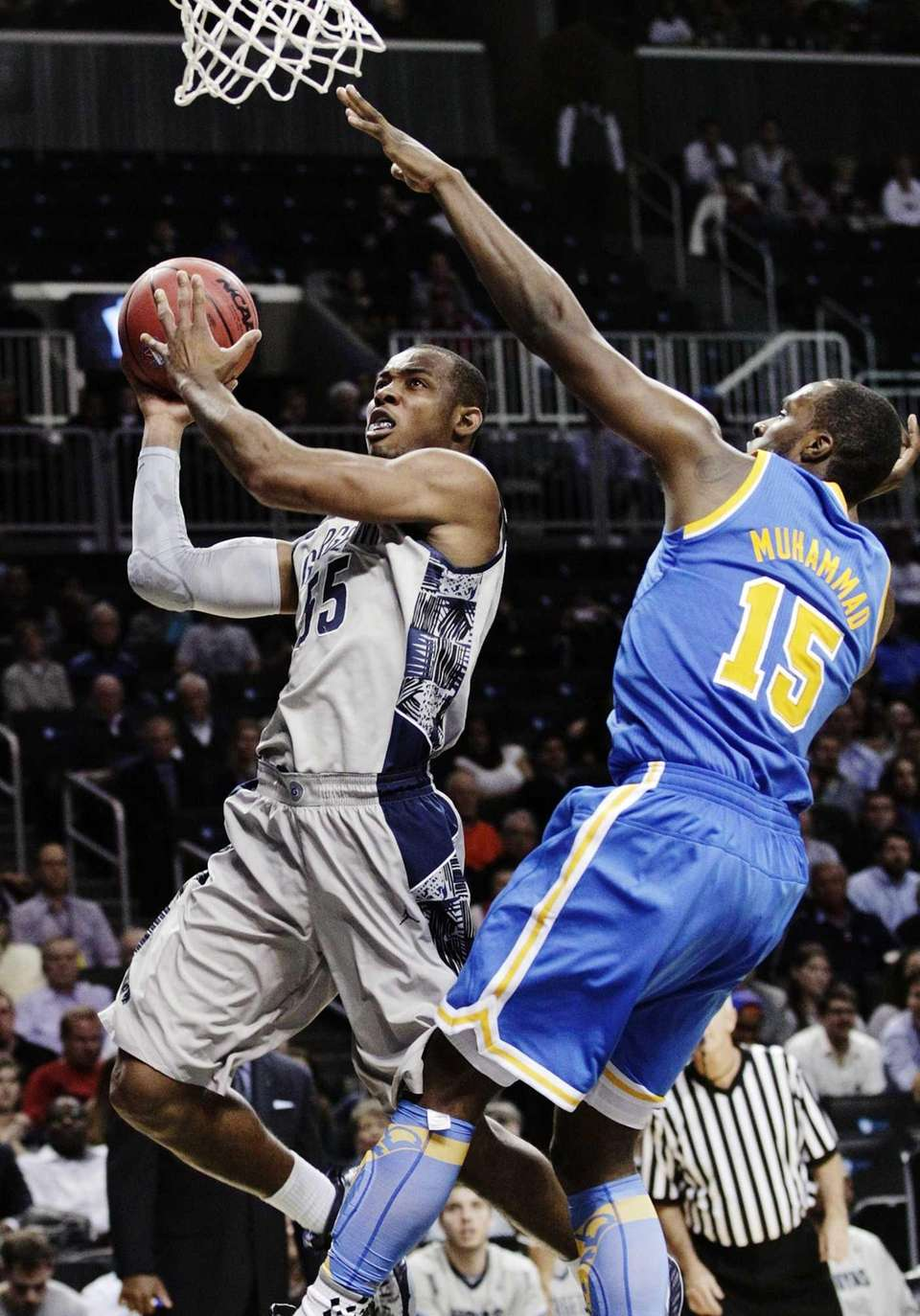 Georgetown's Jabril Trawick drives past UCLA's Shabazz Muhammad
