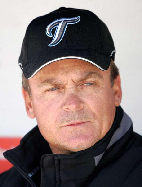 Toronto Blue Jays manager John Gibbons sits in