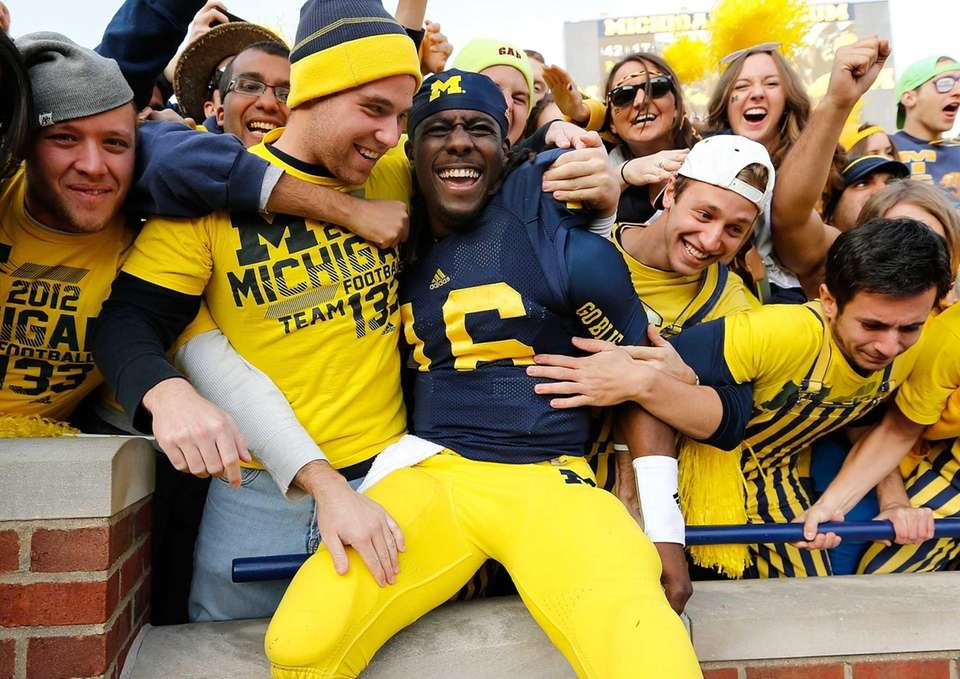 Denard Robinson of the Michigan Wolverines celebrates a