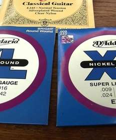 Authentic D'Addario guitar strings are on the left.