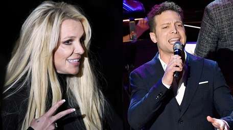 Singer Britney Spears and performer Justin Guarini appear