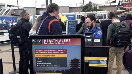 Travelers at a TSA security checkpoint at Denver