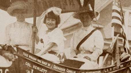 Sitting in the Suffragist wagon, from left, are