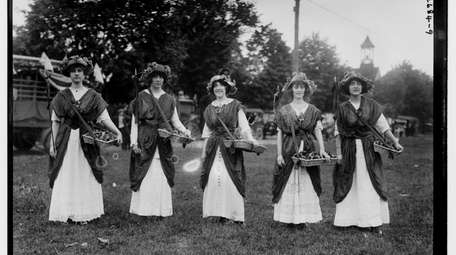 Women in suffrage pageant and parade sell flowers